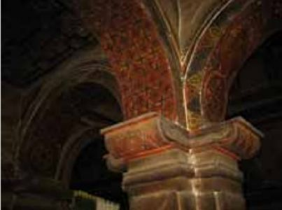 Painted arches and capitals in the north aisle with  triumphal arch in the background. Nave ceiling and west end of the church.Image CHWB