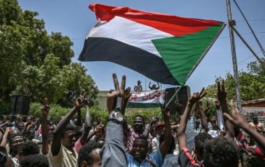sudanese_protesters_shout_slogans_and_wave_national_flags_during_a_protest_outside_the_army_headquarters_in_the_capital_khartoum_on_april_22_2019._afp