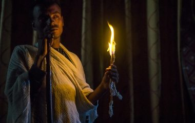 Priest Holding A Candle Inside A Rock Church, Lalibela, Ethiopia