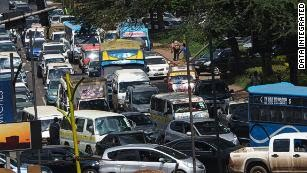 Matatus fighting through the traffic in Nairobi, Kenya.
