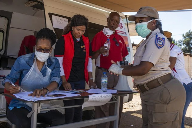 Health-care workers perform health checks at a mobile screening point in Rustenburg.