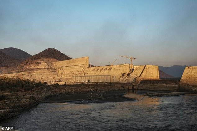 The dam's wall is 145 metres (475 feet) high. Filling the lake that will form behind it will probably take years